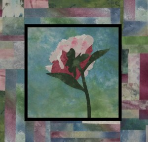 Peony with deeper colored pieced border.